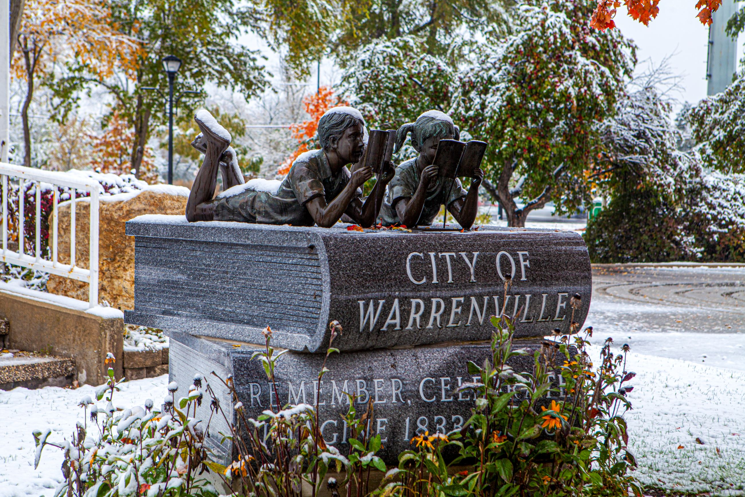 Photo of the Bronze Children sculpture in front of the Gazebo in winter